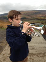 George playing the Last Post